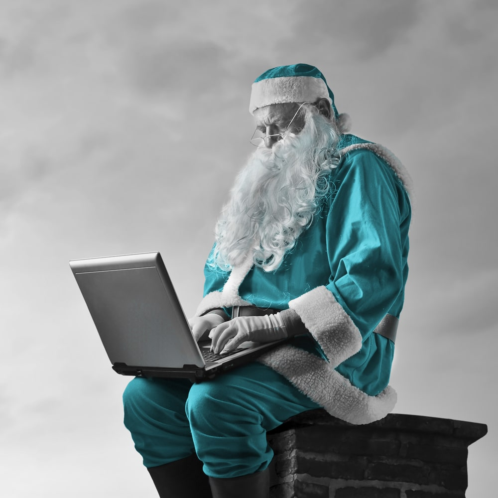 Santa with laptop edit - Strata Plan